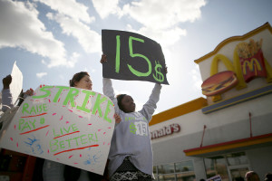Lucila Quero, 18, and Synika Smith, 18, protest outside McDonald's in Los Angeles